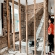 woman in the middle of a house construction